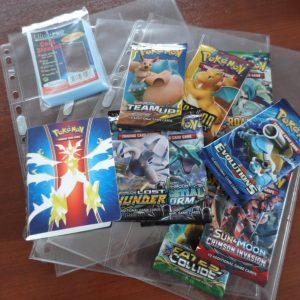 Pokemon super verzamel pakket met 5 boosters/pakjes hoesjes mini-album